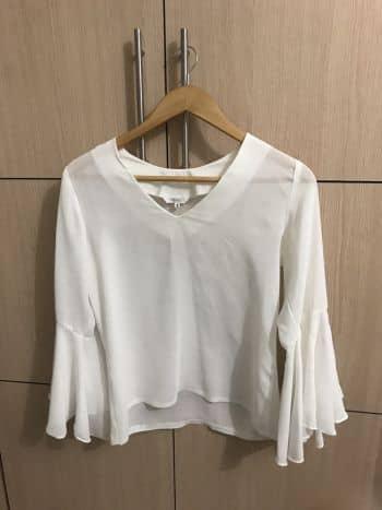 Camisa con bolero en mangas