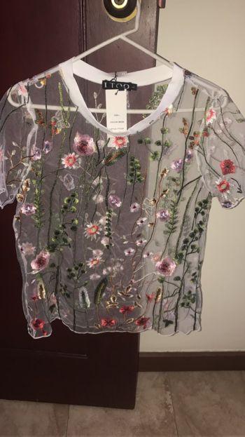 Blusa transparente flores